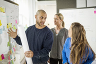 Business people discussing about in creative office - MASF05771