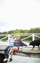 Couple with dog on pier - MASF05849