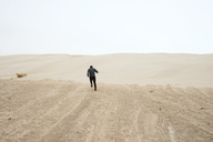 Man running through desert - CAVF43733