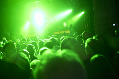 Rays of green lights over crowded dance floor at nightclub - MASF06013