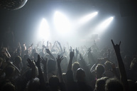Rays of white spotlights over crowded dance floor at nightclub - MASF06016