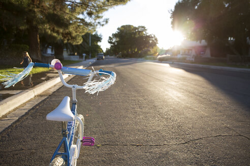 Bicycle on road in city during sunny day - CAVF44099