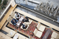 High angle view of business people having a discussion in office - MASF06284