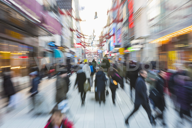 Blurred motion of crowd walking on city street during rush hour - MASF06413