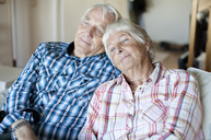 Senior couple relaxing together on sofa in living - MASF06490