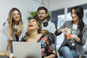 Happy casual coworkers in the office - OCAF00242