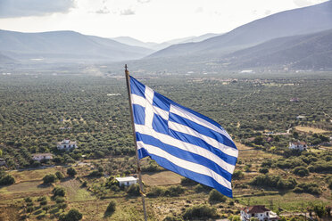 Greece, Peloponnese, Arcadia, Paralia Astros, Flag of Greece, view to fertile plain of Astros - MAMF00071
