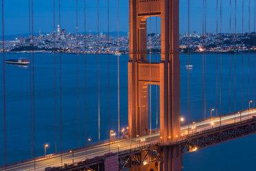 USA, California, San Francisco, Golden Gate Bridge and city at blue hour - MKFF00345