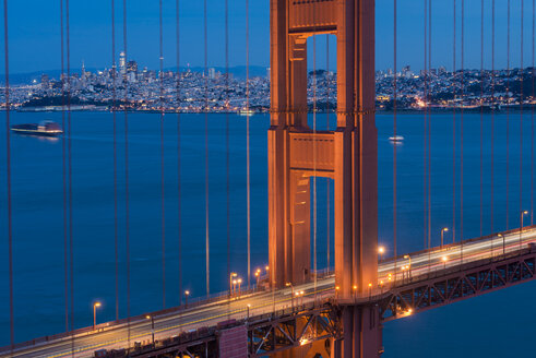 USA, California, San Francisco, Golden Gate Bridge and city at blue hour - MKFF00345