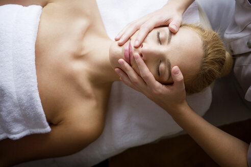 Overhead view of woman receiving massage from female therapist in spa - CAVF45582