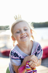 Cheerful girl wearing crown smiling outdoors - MASF06614