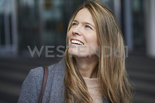 Portrait of smiling businesswoman watching something - PNEF00604
