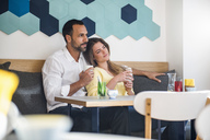 Couple in love drinking coffee in a cafe - DIGF03935