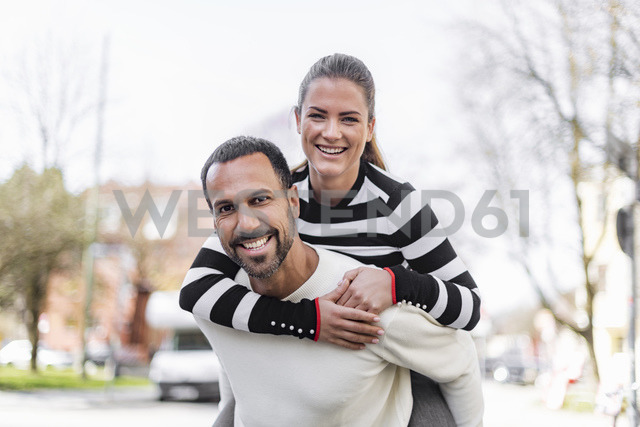 Portrait of happy couple having fun outdoors - DIGF03965