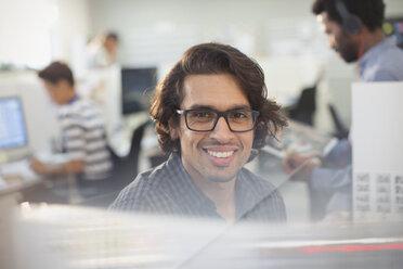 Portrait smiling, confident businessman with eyeglasses - HOXF03425