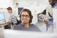 Portrait smiling, confident businessman in office - HOXF03449