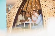 Creative business people meeting in creative workspace teepee - HOXF03482