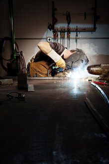 Male worker welding in factory - CAVF45775
