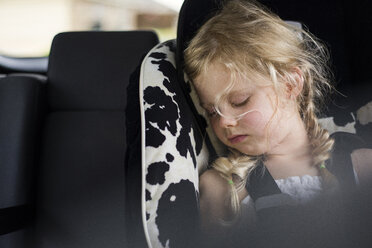 Tired girl sleeping in car - CAVF45925