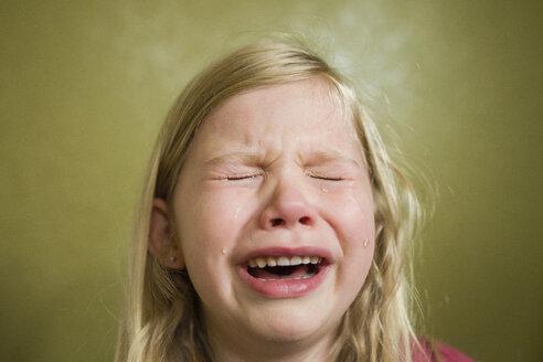 Sad girl crying at home - CAVF45931