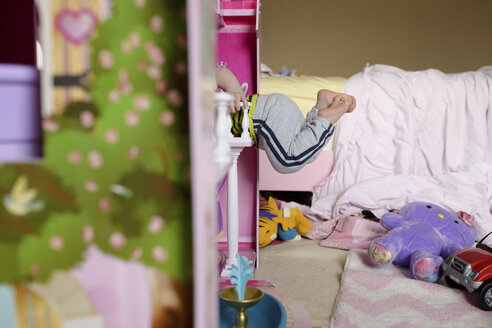 Low section of playful boy in bedroom - CAVF45967