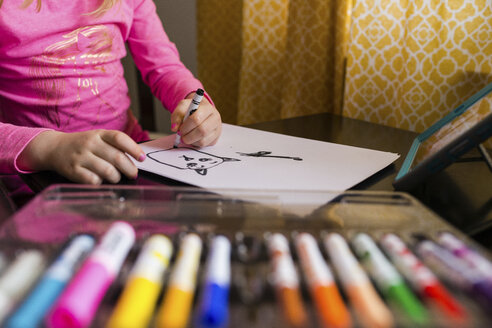 Midsection of girl drawing on paper at home - CAVF46024