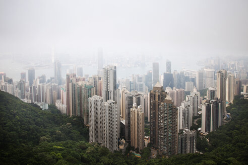 High angle view of Hong King skyline in foggy weather - CAVF46084