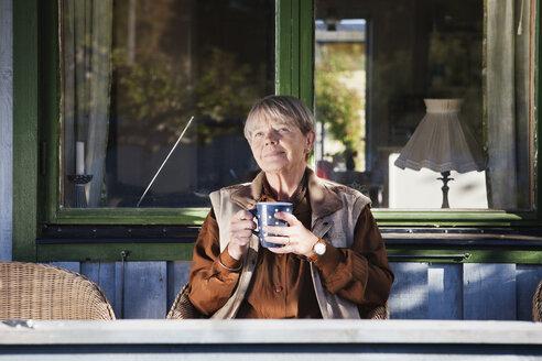 Senior woman holding coffee cup - MASF06854