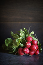 Close-up of fresh radishes on table - CAVF47277