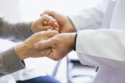 Close-up of doctor holding senior patient hands - CAVF47514