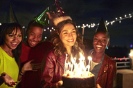 Happy friends with birthday cake at night - CAVF47895