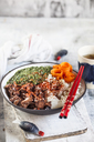 Vegan teriyaki bowl with pulled teriyaki beef made from jackfruit, spinach, rice and carrots - SBDF03534