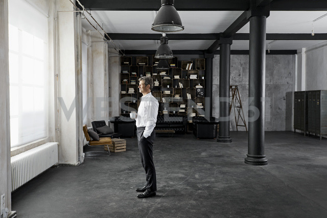 Mature businessman man with cup of coffee in loft - PDF01587
