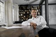 Portrait of mature businessman in loft office - PDF01611