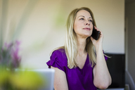 Portrait of blond mature woman  on the phone - MOEF01047