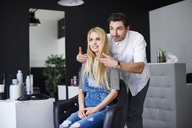 Hairdresser advising his customer - ABIF00346
