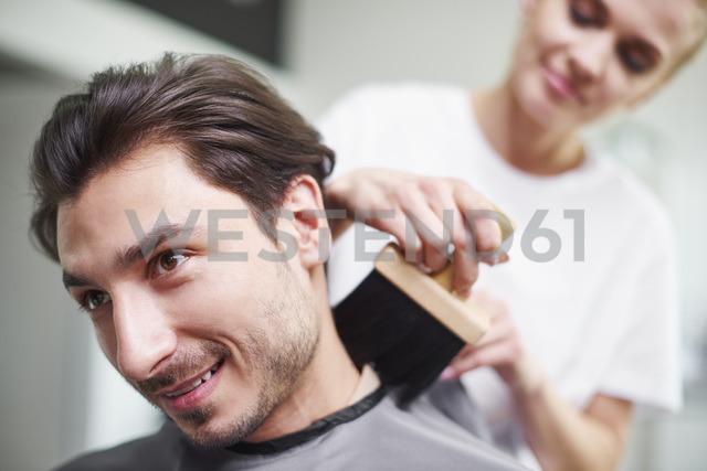 Portrait of smiling man at barber shop - ABIF00352