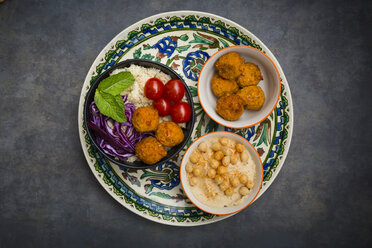 Couscous sweet potato falafel bowl with red cabbage, tomato, mint and hummus - LVF06888