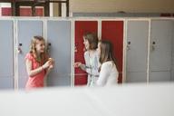 Three girls at lockers in school - MASF07074