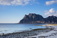 Craggy cliffs and remote ocean beach, Utakliev, Lofoten, Norway - CAIF20345