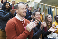 Smiling conference audience clapping - CAIF20429