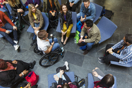 Overhead view speaker in wheelchair with microphone talking with audience - CAIF20432