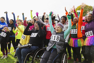 Enthusiastic crowd cheering at charity race in park - CAIF20489