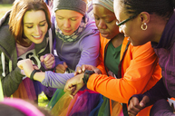 Female runners checking smart watches at charity run - CAIF20492