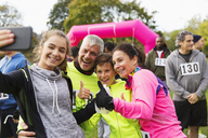 Enthusiastic family runners taking selfie at charity race - CAIF20504