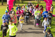 Crowd running at charity run in sunny park - CAIF20507