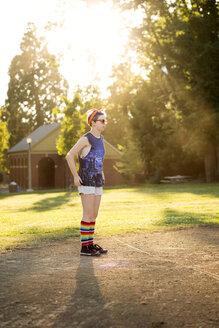 Teenager standing on baseball pitch - CAVF48553