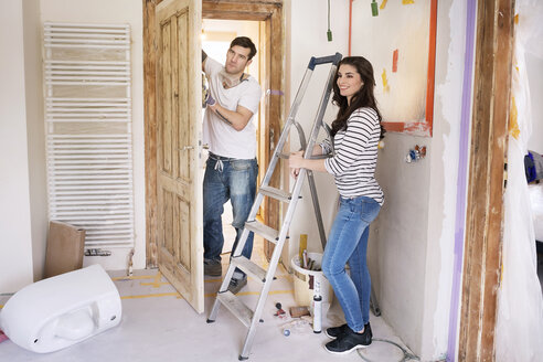 Happy couple renovating new home - PESF01053