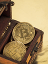 Bitcoins in a box, cryptocurrency - EJWF00877