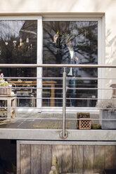 Senior businessman drawing formula on his patio door - GUSF00678
